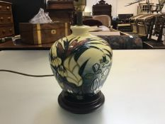 A Moorcroft pottery baluster table lamp decorated with water lily and iris design, yellow ground (