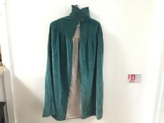 A 1920s turquoise cotton velvet cape with pink satinised velvet lining, with ruched collar and