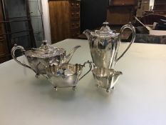 An Epns four piece tea and coffee set with panelled engraved chased sides, with sugar basin and