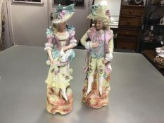 A pair of 19thc Continental Beau and Lady bisque figures, decorated with polychrome enamels (h.38cm.