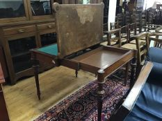 A Victorian figured walnut shaped top foldover card table, the top (a/f) with crossbanded border and