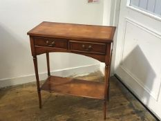 A yew wood side table, the rectangular top with crossbanded border above two frieze drawers, on