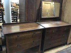 An oak two piece bedroom suite comprising a dressing chest with rectangular mirror above two short