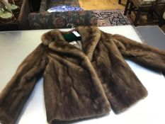 An AE Ball, George Street, Edinburgh lady's ranch mink short evening jacket with notched lapels