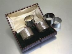 A pair of Birmingham silver engine turned napkin rings, two Epns napkin rings and a Birmingham