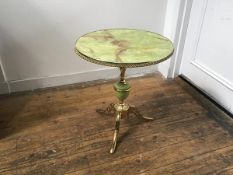 A 1960s brass plated metal faux onyx pedestal table on brass plated tripod support (h.56cm x d.