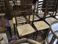 A set of four 19thc style spindle back rush seat dining chairs on turned tapered supports (h.84cm