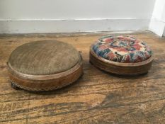 Two Victorian walnut inlaid circular footrests with upholstered tops on ceramic fluted supports (h.