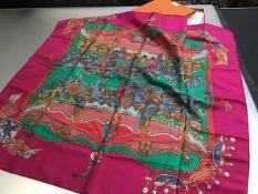 A silk scarf by Hermes, Paris, Tournez Manege, complete with original box (90cm x 90cm)
