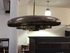 A Danish 1960s brass plated circular pendant light fitting with triple circular tapered insert (h.