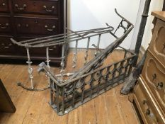A pair of 19thc wrought iron window balconies (h.31cm x 98cm x 28cm) (losses) and another (h.48cm