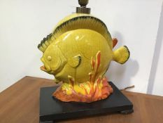 A 1950's novelty table lamp, modelled as a tropical fish amidst coral, in a yellow crackle glaze,