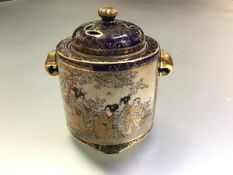 A Japanese Satsuma pottery pot pourri, Meiji period, c. 1900, of cylindrical form, painted with