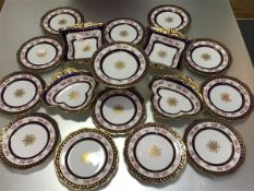 An Edwardian Aynsley dessert service, c. 1905-10, each piece centred by a gilt roundel, the rims