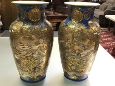 A pair of large Satsuma vases, Meiji period, c. 1900, each of baluster form, lavishly decorated in