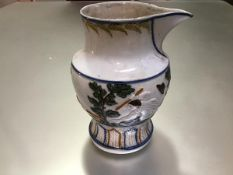 """A Pratt Ware """"Fox and Goose"""" jug, c. 1790, moulded and polychrome painted with a scene from the"""