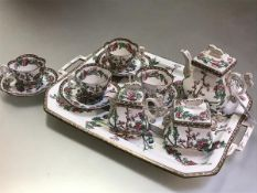 A Coalport Indian Tree pattern cabaret service for our, c. 1880, the teapot, covered cream and