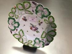 """A Longton Hall porcelain """"Strawberry Leaf"""" plate, c. 1755-60, enamel painted to the well with floral"""