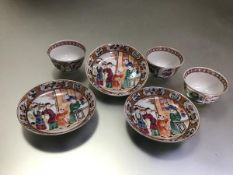 A set of three Chinese porcelain tea bowls and saucers, the bowls polychrome painted with figural