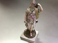 A Staffordshire pearlware figure of Diana, early 19th century, modelled standing, her left handing
