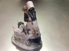 A Royal Copenhagen porcelain group, the goatherd, no. 694, painted and printed marks. 23cm
