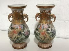 A pair of striking Kutani porcelain vases, Meiji period, c. 1900, each of baluster form with