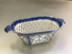 An early 19th century Staffordshire pearlware chestnut basket, of shaped rectangular form, with