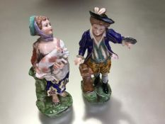 A pair of 19th century porcelain figures of a boy and girl, in 18th century style, she a