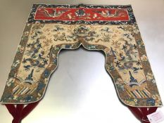 A Chinese portiere or door hanging, c. 1900, worked in polychrome silk and gilt threads on cotton