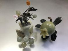 A group of Chinese jade and hardstone carvings comprising: a pomegranate with spinach jade leaves; a