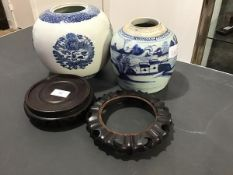 Two 20thc ginger jars, both missing lids, together with two Chinese circular hardwood stands (a
