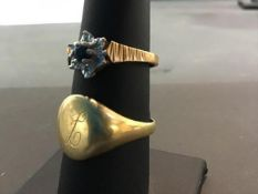 An 18ct gold gentleman's signet ring (6.4g) together with a hallmarked gold lady's sapphire set
