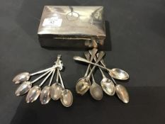 A silver cigarette box together with two sets of six hallmarked silver coffee spoons (a lot)