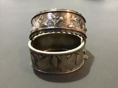 Two Victorian white metal hinged bangles (2)