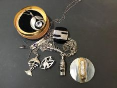 A mixed lot of white metal and silver jewellery including a circular white metal brooch/pendant, a