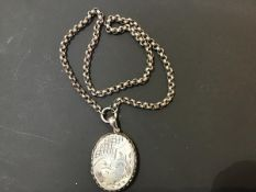 A Victorian oval engraved white metal locket on belcher style white metal chain (l.47cm) (32.3g)