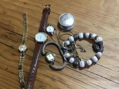 A mixed lot of jewellery and watches including a hallmarked silver circular pill box, four lady's