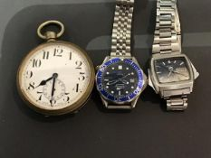 A mixed lot of watches including an oversized pocket watch, a Seiko stainless steel vintage