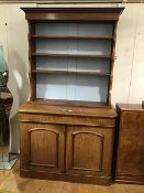 A Victorian mahogany two part dresser, the converted open top with moulded cornice, fitted three