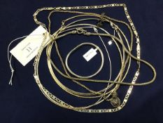 A mixed lot of white metal chains and necklaces including a fancy link chain, a rope chain, two