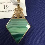 A 9ct gold double sided agate set pendant of polygon form, set green agate to one side, blue agate
