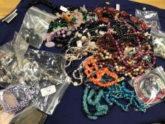 A mixed lot of beads, necklaces, pendants, bracelets, many set hardstone, mother of pearl,