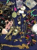 A collection of jewellery including pendants, brooches, hardstone beads, a white metal watch by