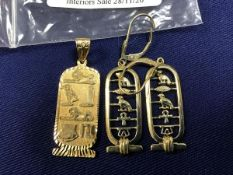 A pair of Egyptian design yellow metal earrings marked 975 together with a pendant of similar design