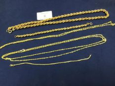 A group of yellow metal chains and bracelets, marked 9ct, including a rope necklace (50cm), bracelet