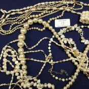 A mixed lot comprising two strands of pearl beads with yellow metal clasp, together with