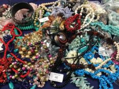 A box containing a large quantity of mixed beads and necklaces, including freshwater pearls,