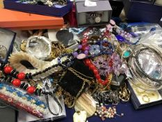 A box containing a large quantity of costume and vintage style jewellery including watches,