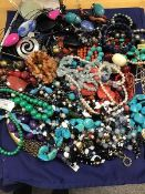 A mixed lot of jewellery comprising pendants, bead necklaces including polished hardstone, pebble