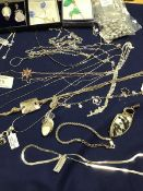 A mixed lot of jewellery including gem set pendants and necklaces, chain link bracelets, chains,
